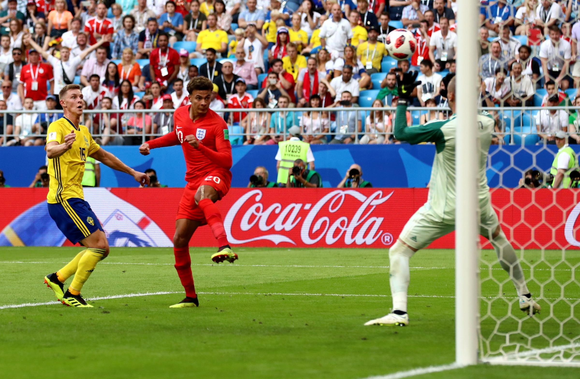 LIFTING SPIRITS: England's Dele Alli scores his side's second goal of the 2-0  World Cup quarter-final victory over SwedenPicture: Tim Goode/PA Wire