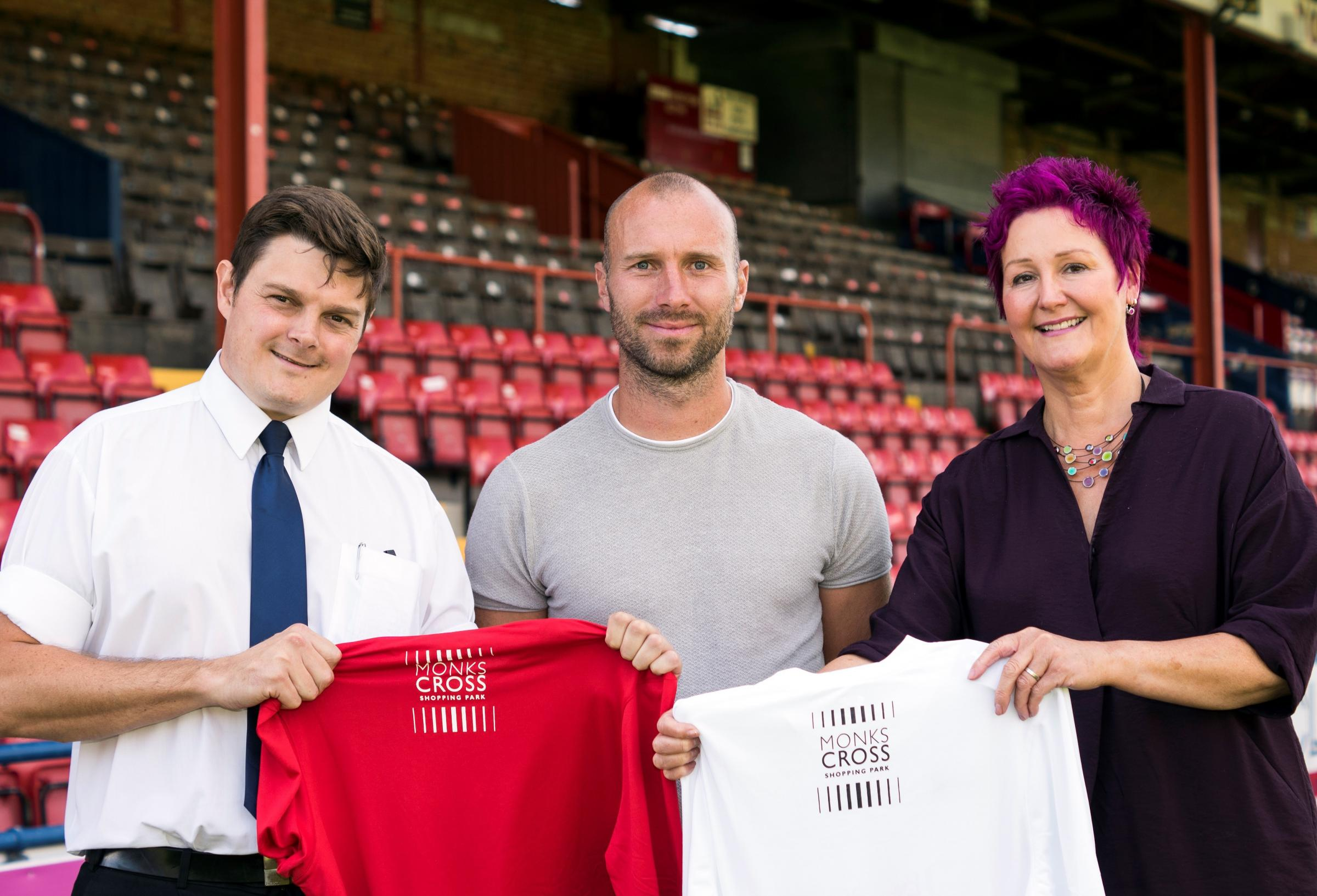 WELCOME BACK: Returning York City midfielder Russ Penn (centre) poses with Katherine Sharp, the centre manager for new back-of-the-shirt sponsors Monks Cross Shopping Park. City supporter Carl Dales, who is the security supervisor at Monks Cross, is also