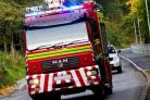 Elderly woman taken to hospital after living room fire