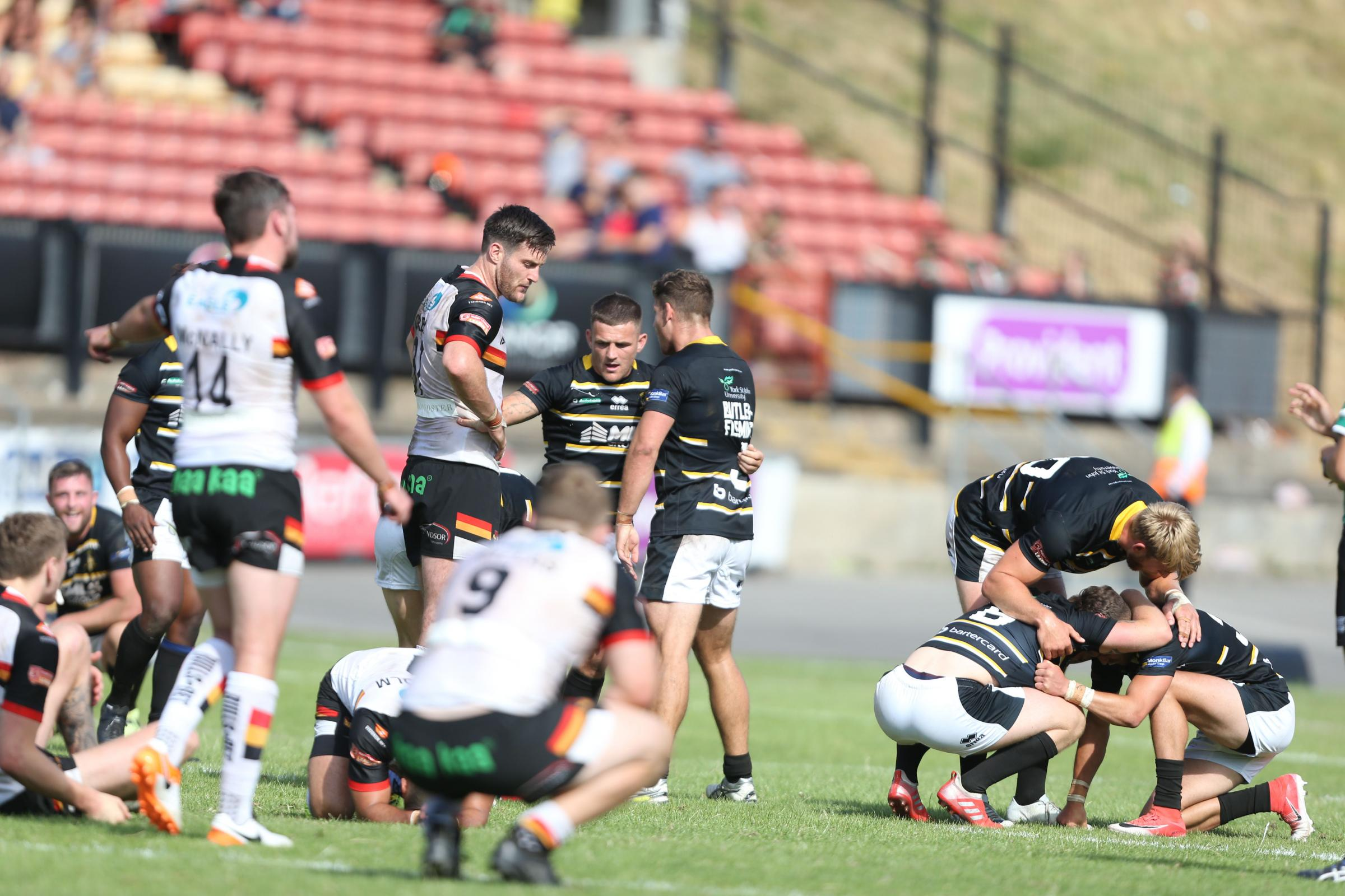 York City Knights celebrate while Bradford Bulls players look dejected following the Knights' nailbiting victory at Odsal in July during the two teams' battle for the Betfred League One title. Picture: Gordon Clayton