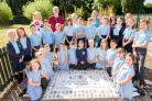Children from St Mary and St Joseph RC Primary in Pocklington celebrate more than 50 years since it opened on the Maxwell Road site by making a stunning floor mosaic. With them are teaching staff and Gerry and Lyn Grant from Fangfoss Pottery