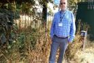 CONCERN: Cllr Keith Myers at the former Manor School site, where travellers have set up camp