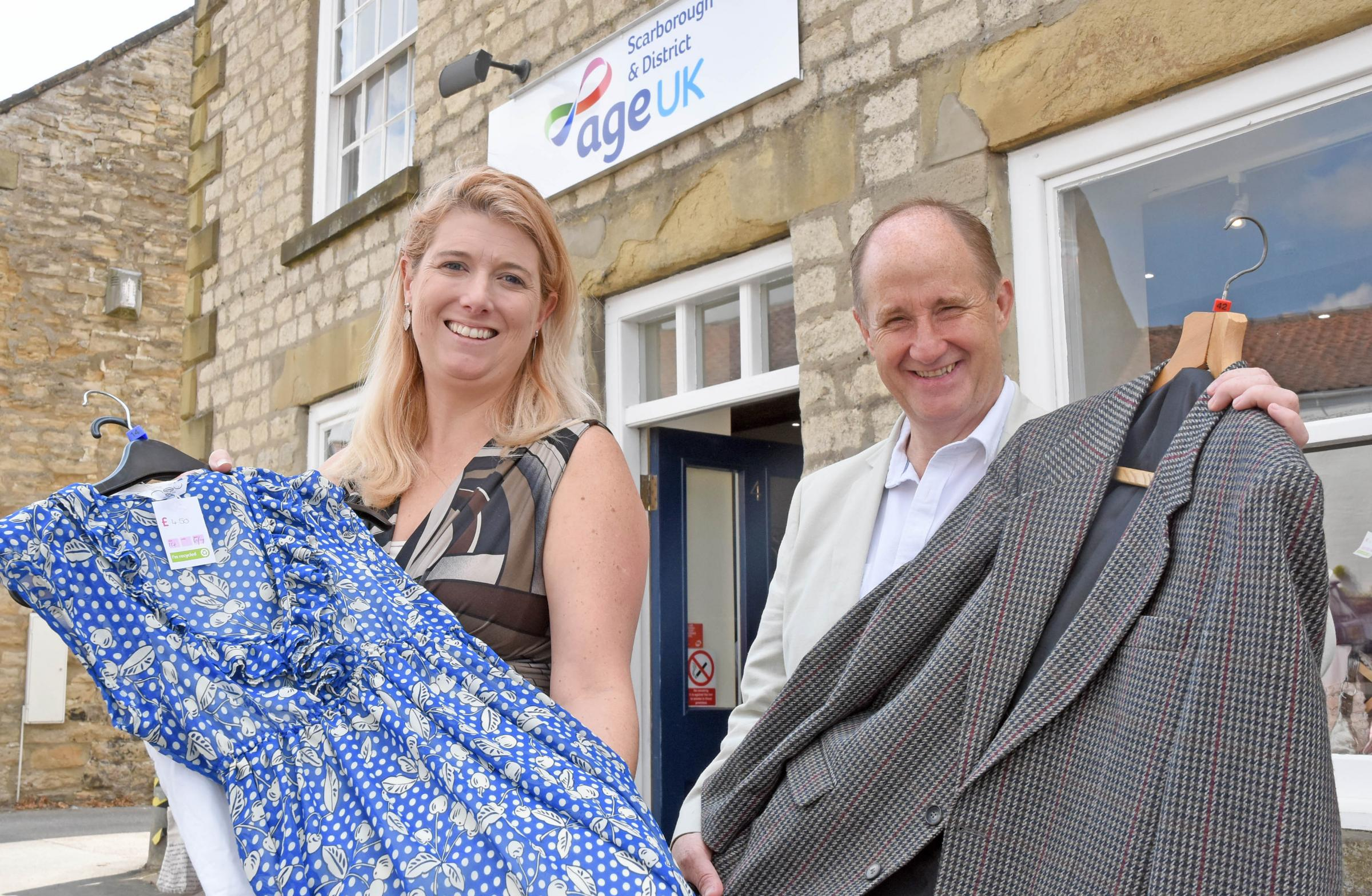 Julie-Anne Macey, chief executive of Age UK Scarborough and District, at the opening of its new shop in Helmsley, helped Ryedale MP Kevin Hollinrake                                                        Picture: Nigel Holland