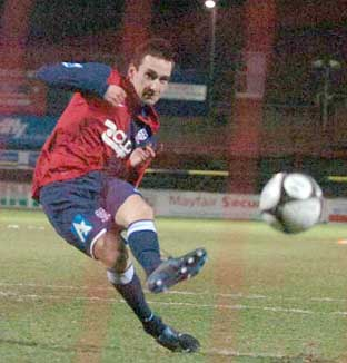 York City's Mark Robinson hits the back of the net in the shoot-out against Kidderminster Harriers