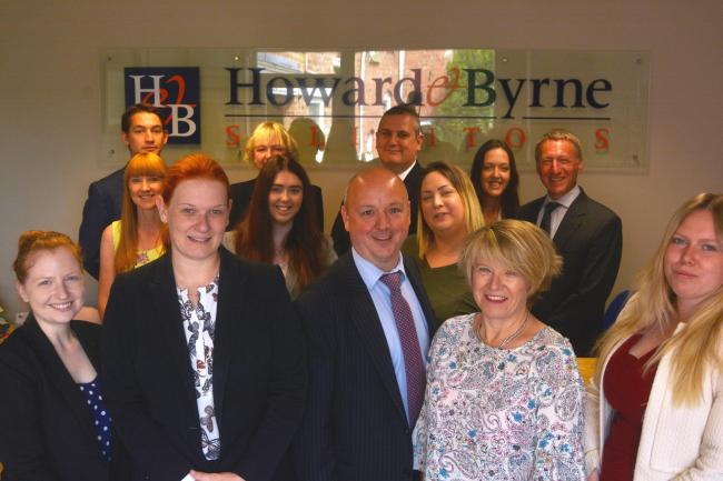 Staff and lawyers at Howard & Byrne celebrate the firm's win in the Yorkshire Legal Awards