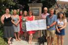 From left, Kathryn Craven, Leila Harrison, Anneli Shearsmith, Julie Box, Chrissie Wilson, John Box, with Rufus the Dog, Stephen Rooke and Emily Wilson during the cheque presentation Picture: Sarah Gilbank
