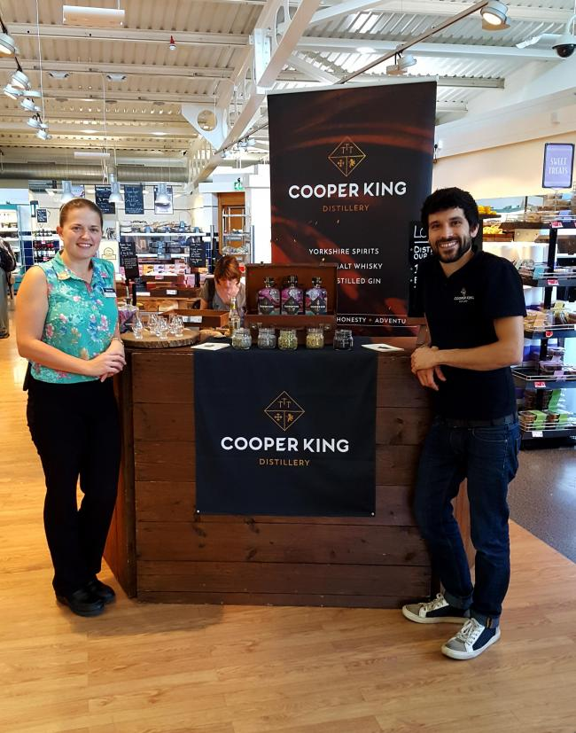 Chris Jaume of Cooper King, right, with staff in Booths