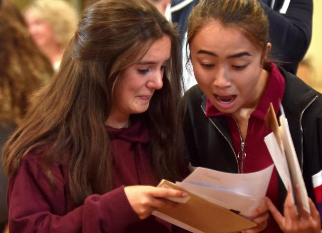 Pupils picking up their results from Huntington School in 2018