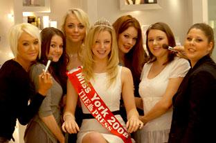 Reigning Miss York, Helen Jackson, with some of this year's entrants having a makeover at Fenwick, in York.