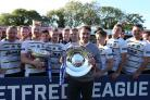 TOP MAN: York City Knights coach James Ford with Betfred League One silverware after his team secured the title at Bootham Crescent. Picture: Gordon Clayton