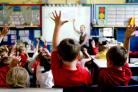 Young children in a classroom, as campaigners said councils did not have enough money to fulfil their legal obligation to provide care for pupils with a range of disabilities and conditions