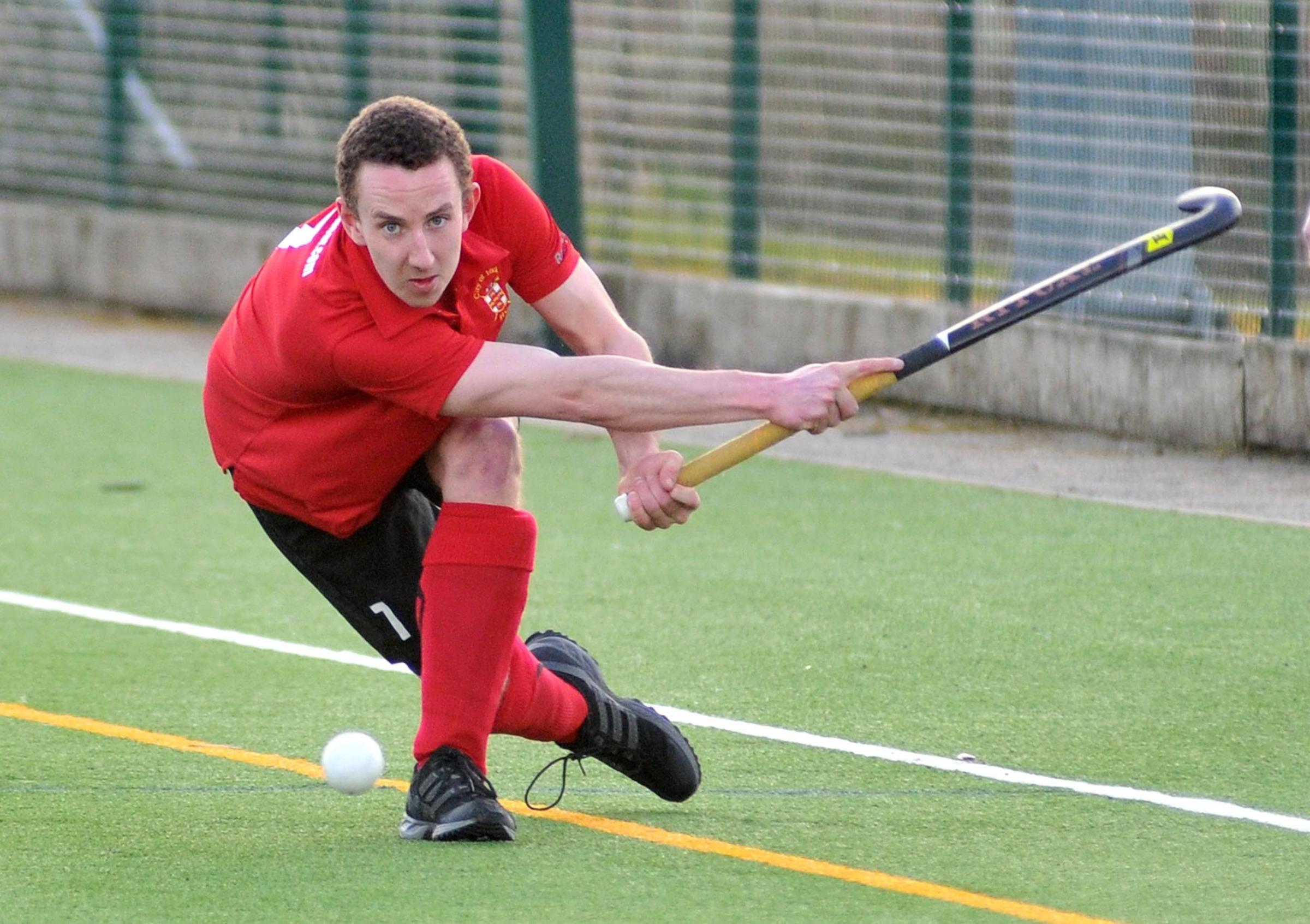 York Hockey Club Mens 1st (red) v Manchester 1st (yellow). Pictured in first half action is York's Mike Carter. Picture: David Harrison..