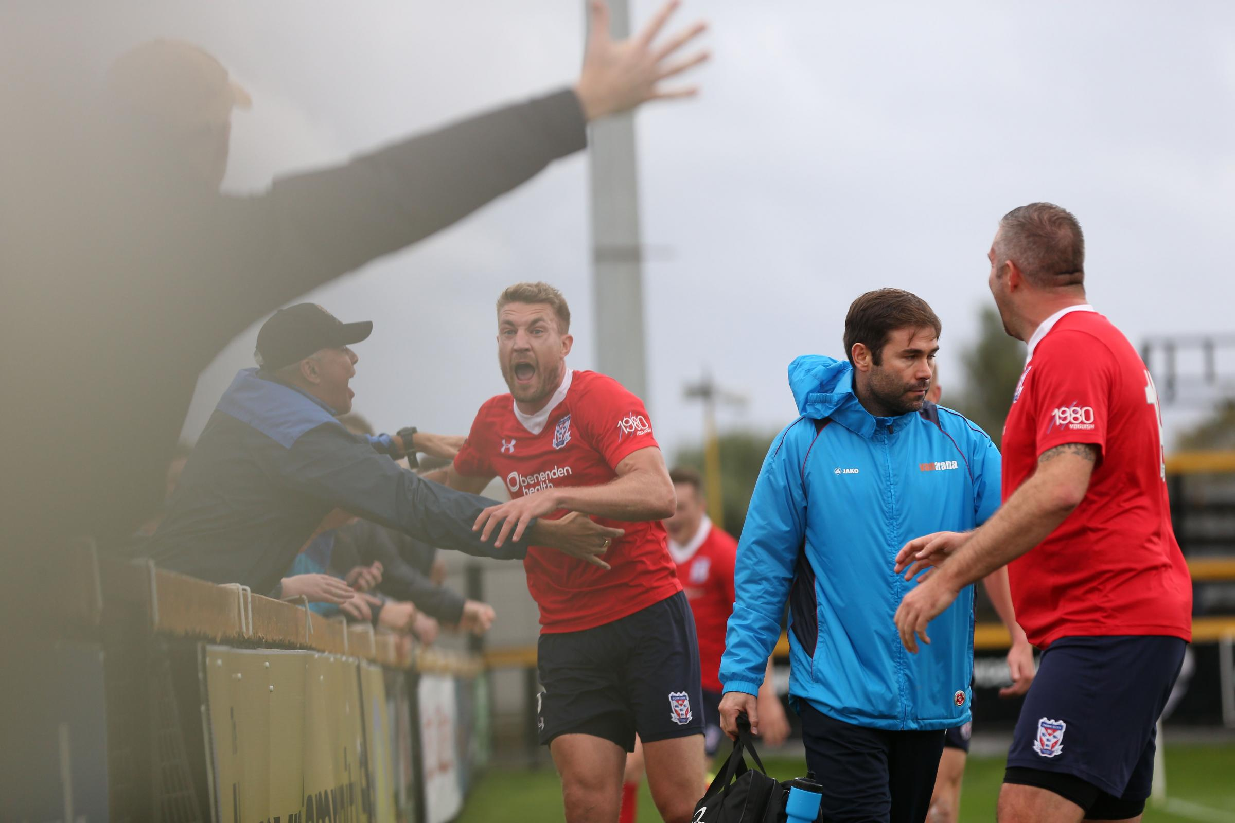 FAN-TASTIC: Simon Heslop wheels away to celebrate with York City's supporters after blasting in a spectacular 84th-minute winner at Southport. Picture: Gordon Clayton
