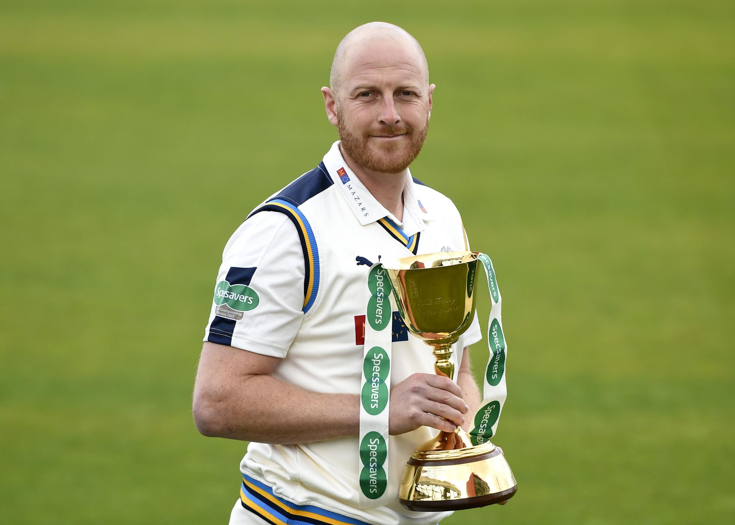 Andrew Gale holds aloft the County Championship Trophy which Yorkshire won in 2014 and 2015. The coach believes it could be two to three years before they become title contenders again     Picture: Martin Rickett/PA Wire