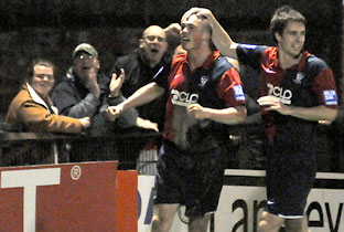 City striker Richard Brodie celebrates with defender David McGurk, right, and the York fans after his shot  rebounded in off Forest Green's  'keeper