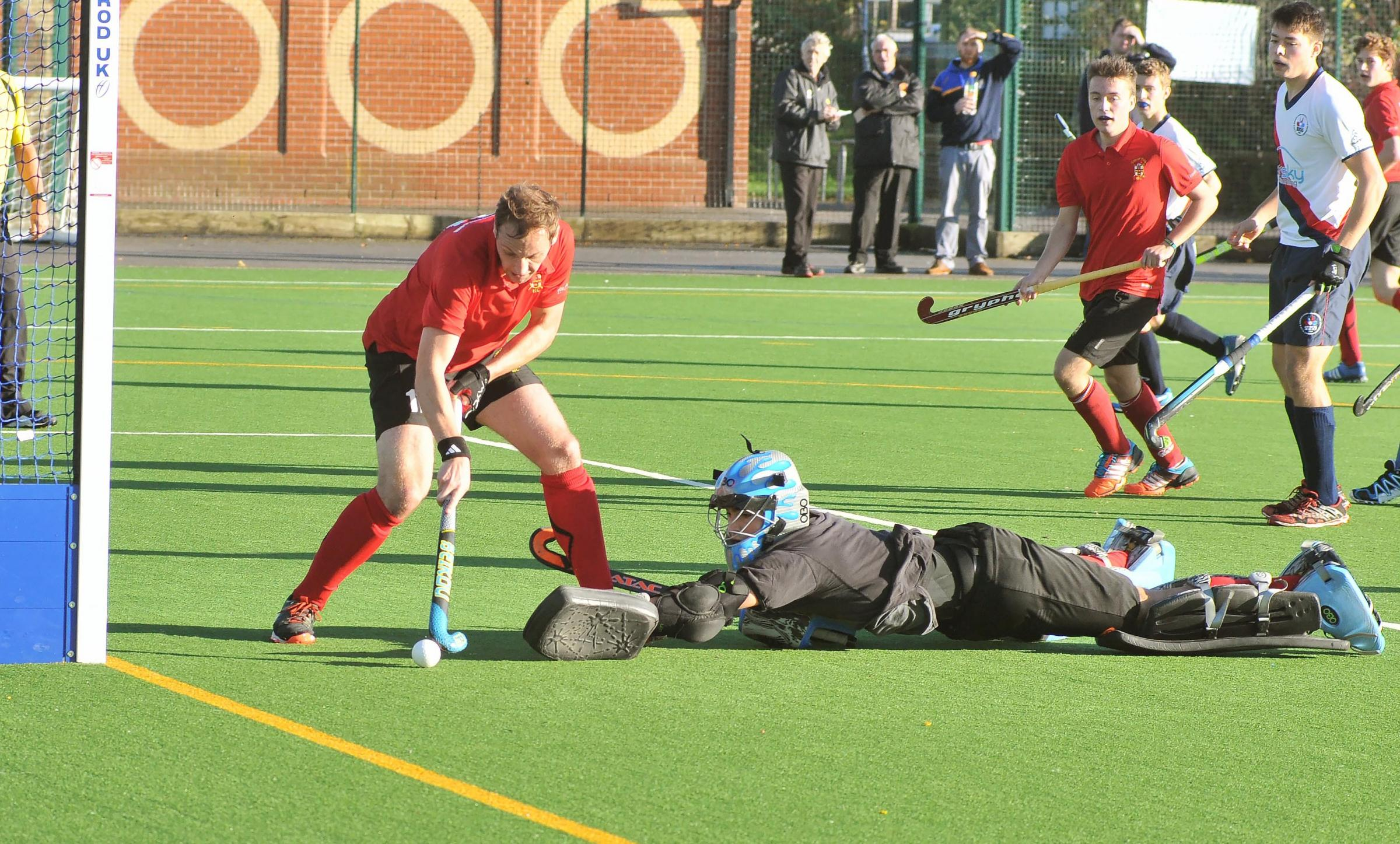 York Mens Hockey (red) v Brooklands. Pictured in action is Yorks Alex Cockram scoring. Picture David Harrison..