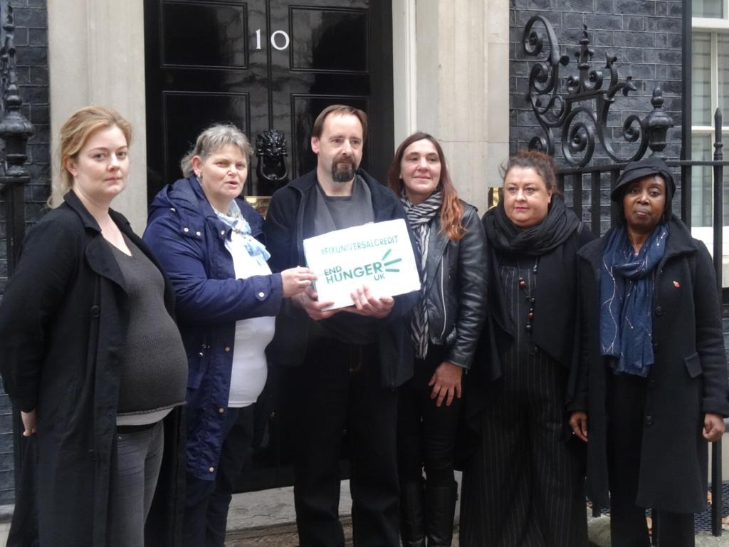 The petition is handed over at 10 Downing Street, by End Hunger UK campaigners, including York couple Tony Carson and Sue Rimington (centre of picture)