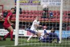 LEVELLER: David Ferguson pounces to score York City's equaliser at Swindon. Picture: Ian Parker