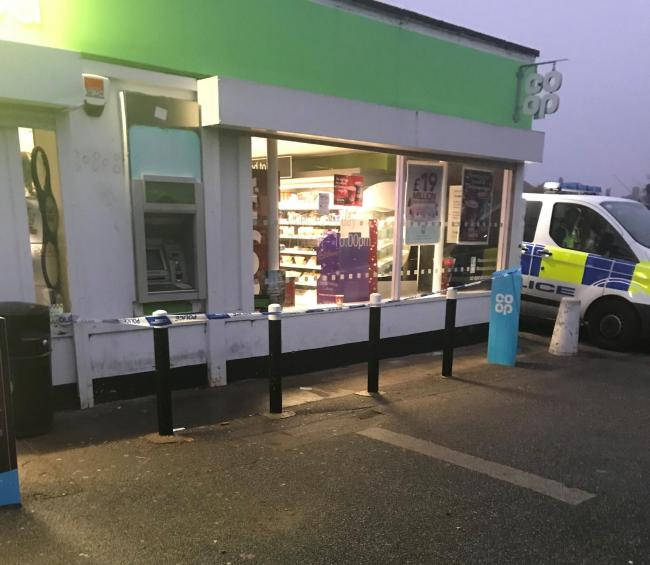 Police tape around the cash machine at the Co-op store on Beckfield Lane, York. Picture: Téba Diatta