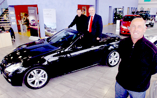 York City manager Martin Foyle, right, and assistant manager Andy Porter, left, with an SLK 280 Mercedes with Nick Lawn, centre, group sales manager for Mercedes Benz Clifton Moor