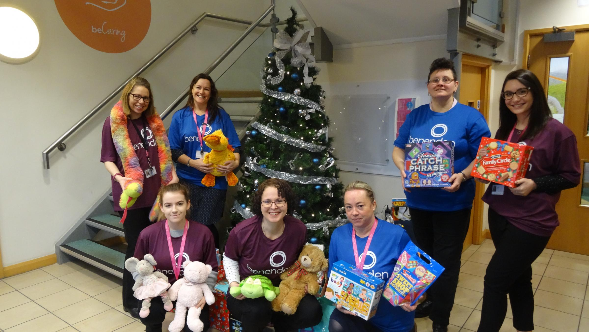 Staff at Benenden pictured with some of the gifts donated by colleagues