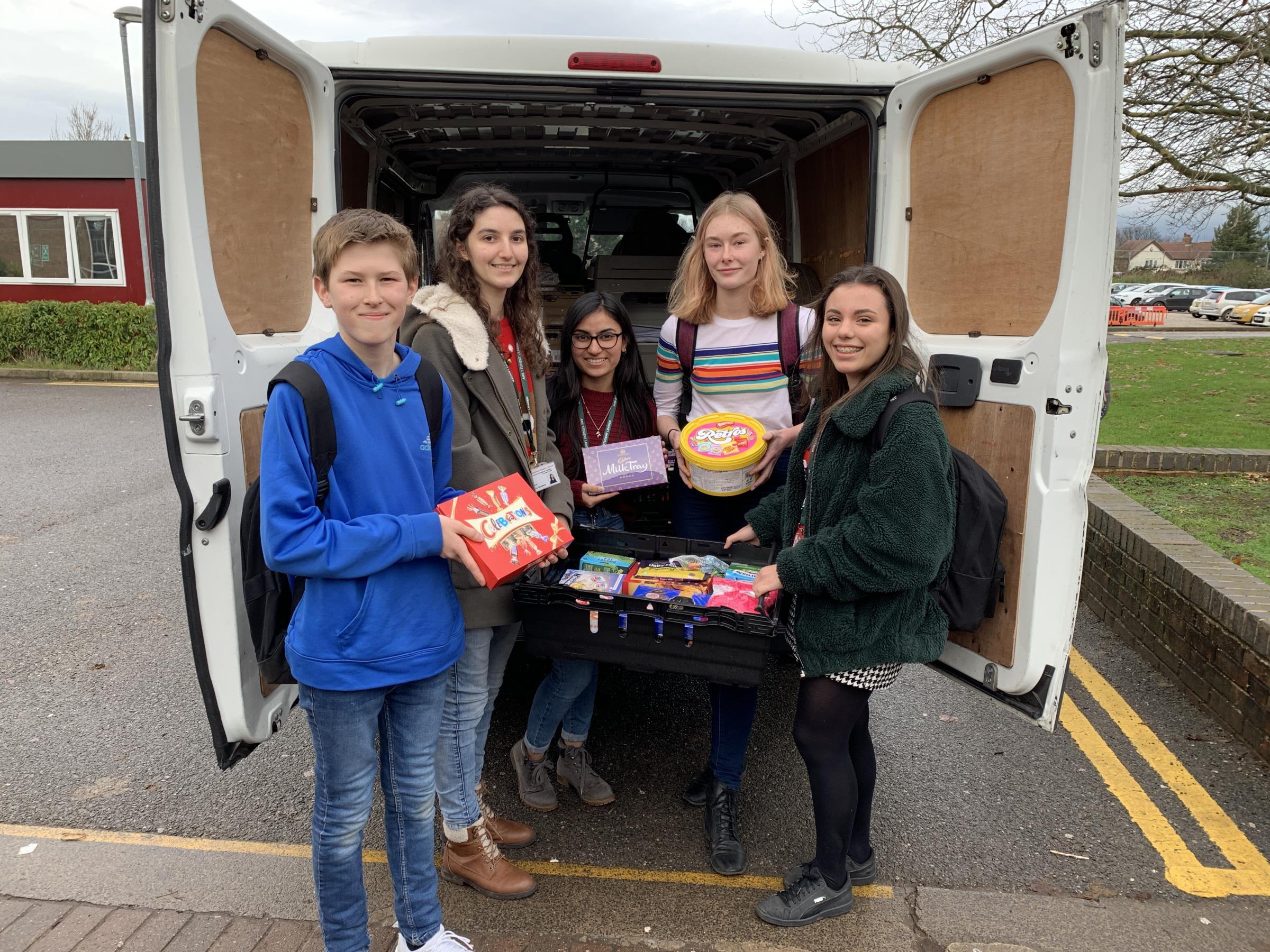 GIFTS: Students at Archbishop Holgate's School load a van full of donations for York Foodbank.
