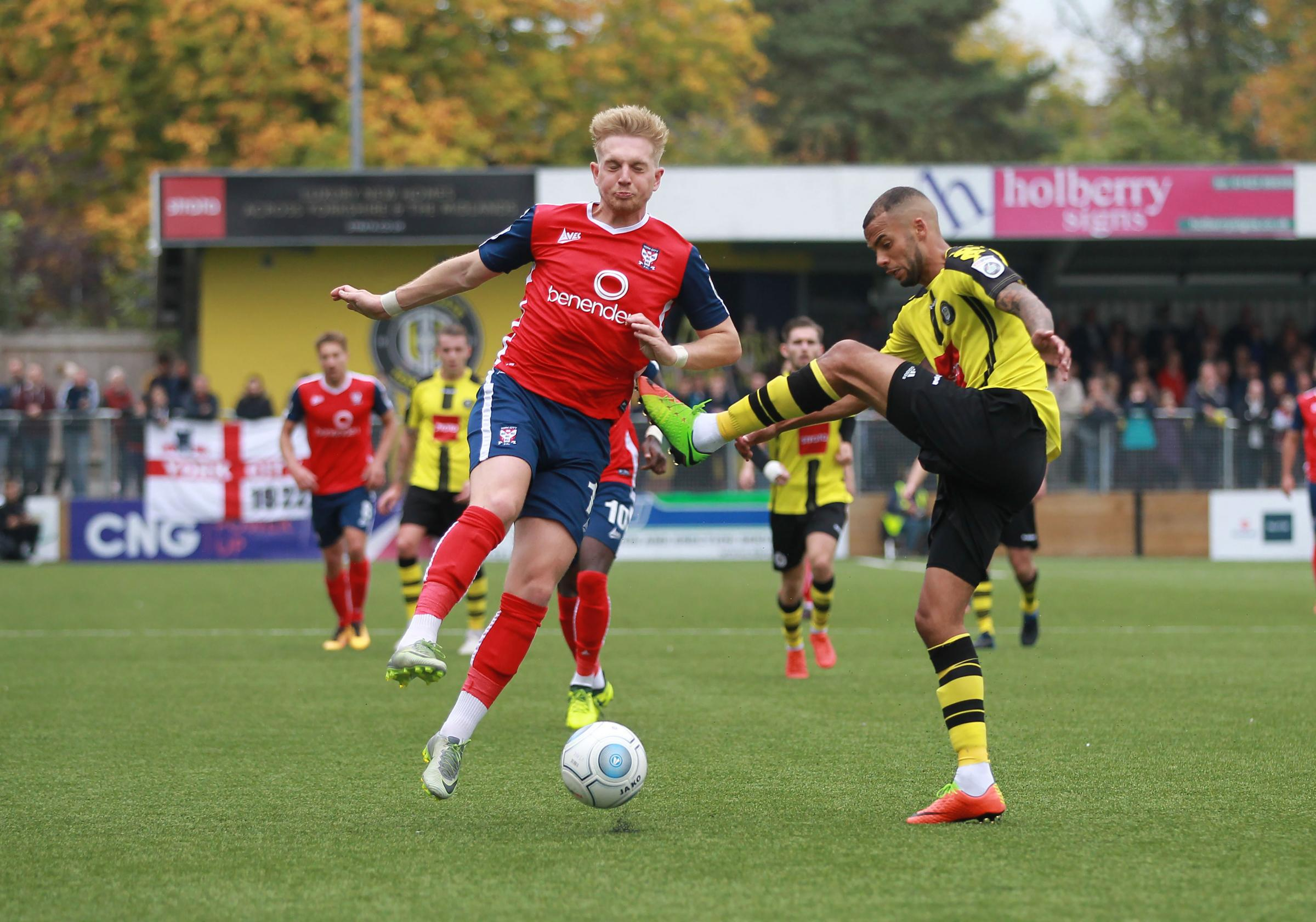 Harrogate Town�s Warren Burrell challenges York City's Louis Almond.Harrogate Town v York City . Vanararma National League  North clash held at The CNG Stadium on the 23/09/2017.Pic by Gordon Clayton.Football  Images are covered by DataCo  &am