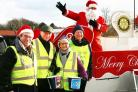 Santa on tour with Rotary York Ainsty Rotarian 'collection Elves' - Peter Kendall, John Merchant, Christine True and John Niklaus at Morrison's supermarket, Foss Islands Road, York.