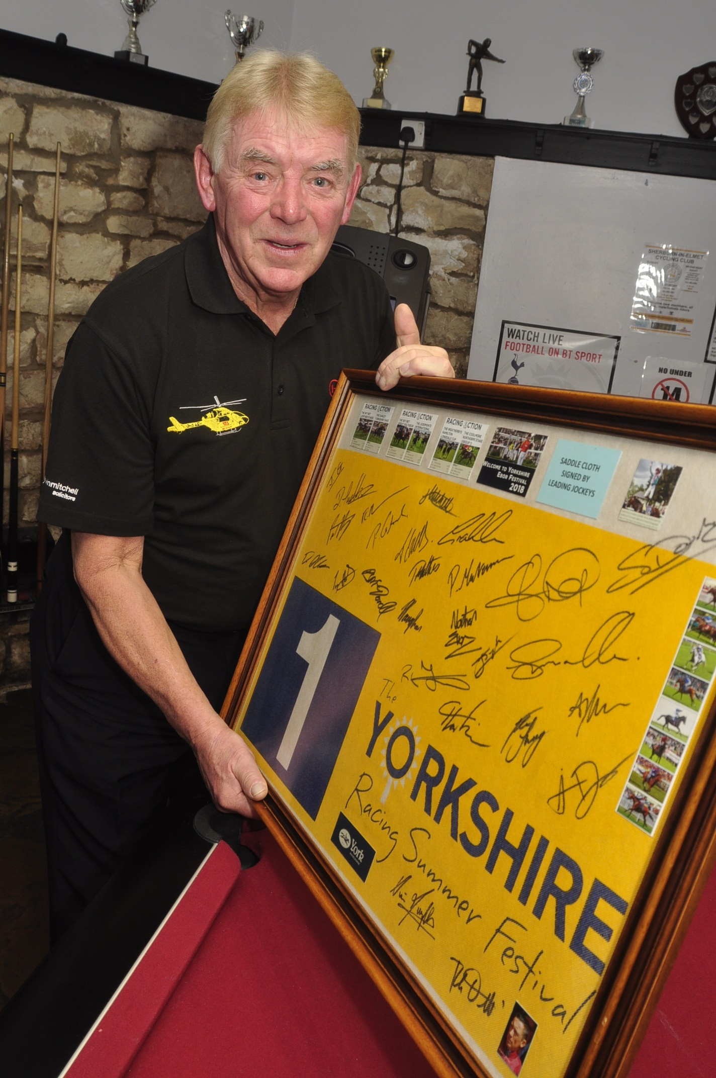 Malcolm Dowson with his mural he has made and raised £500 for Yorkshire Air Ambulance. Picture by Eric Foster