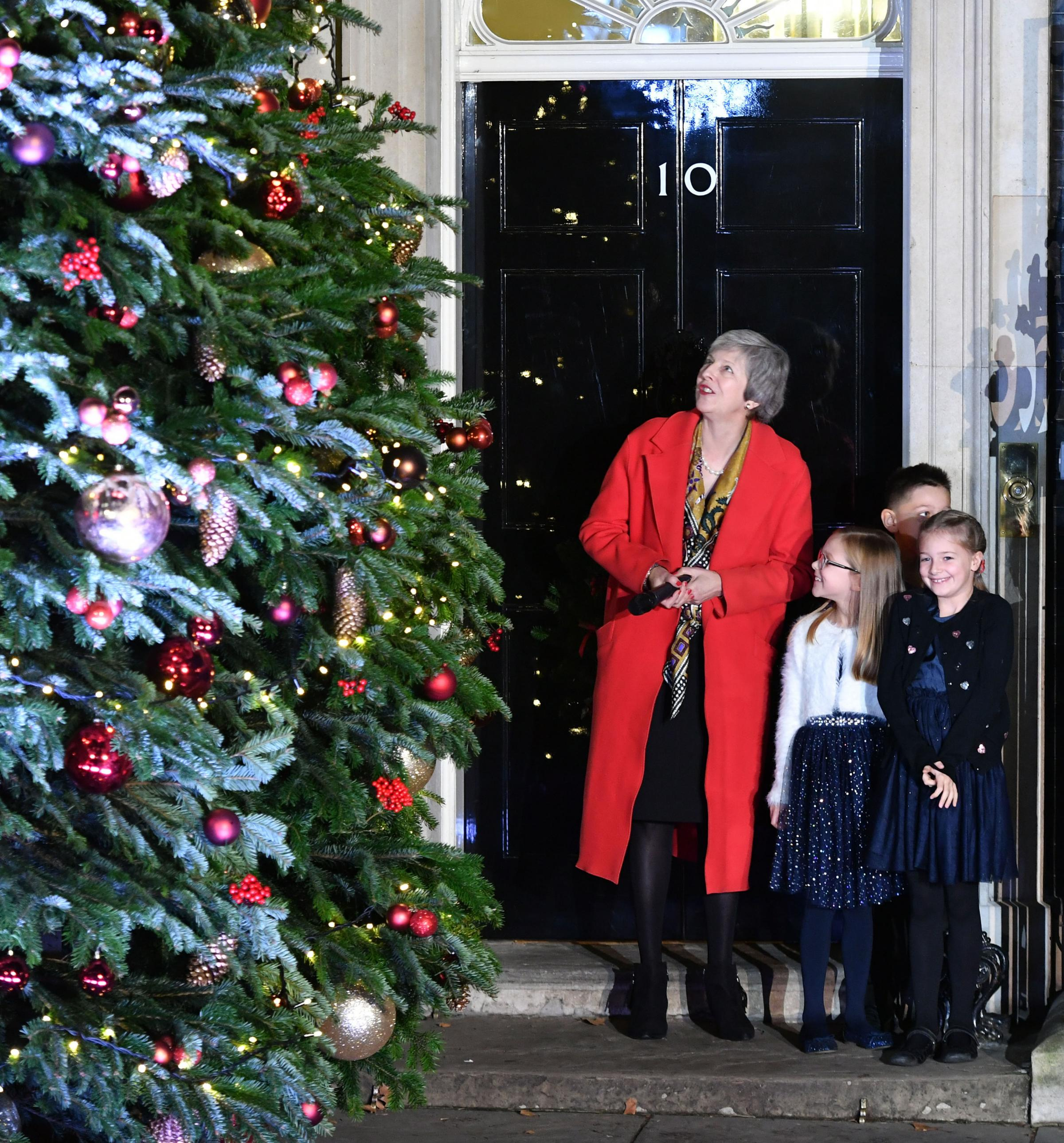 Theresa May switching on the Downing Street Christmas lights. Our columnist ponders her fate should she be a panto character