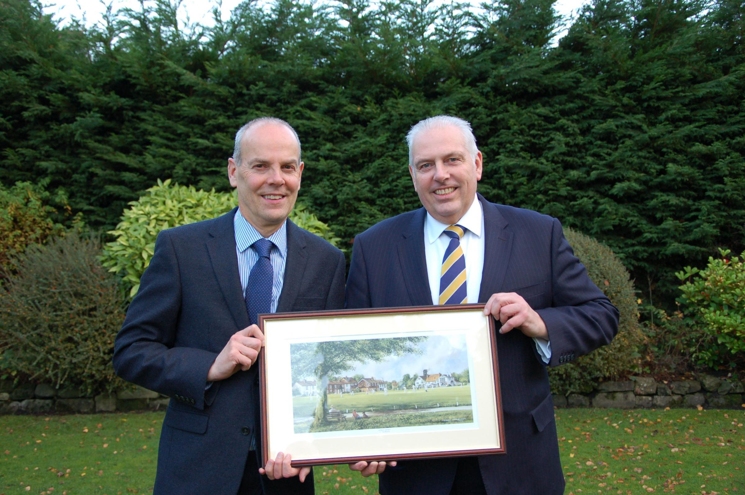 FIRM SUPPORT: Charles Walker (left) and Robert Woolley of HPH were presented with a watercolour painting by York Vale Cricket League chairman Shane Hargrave to celebrate 25 years of sponsorship from the firm