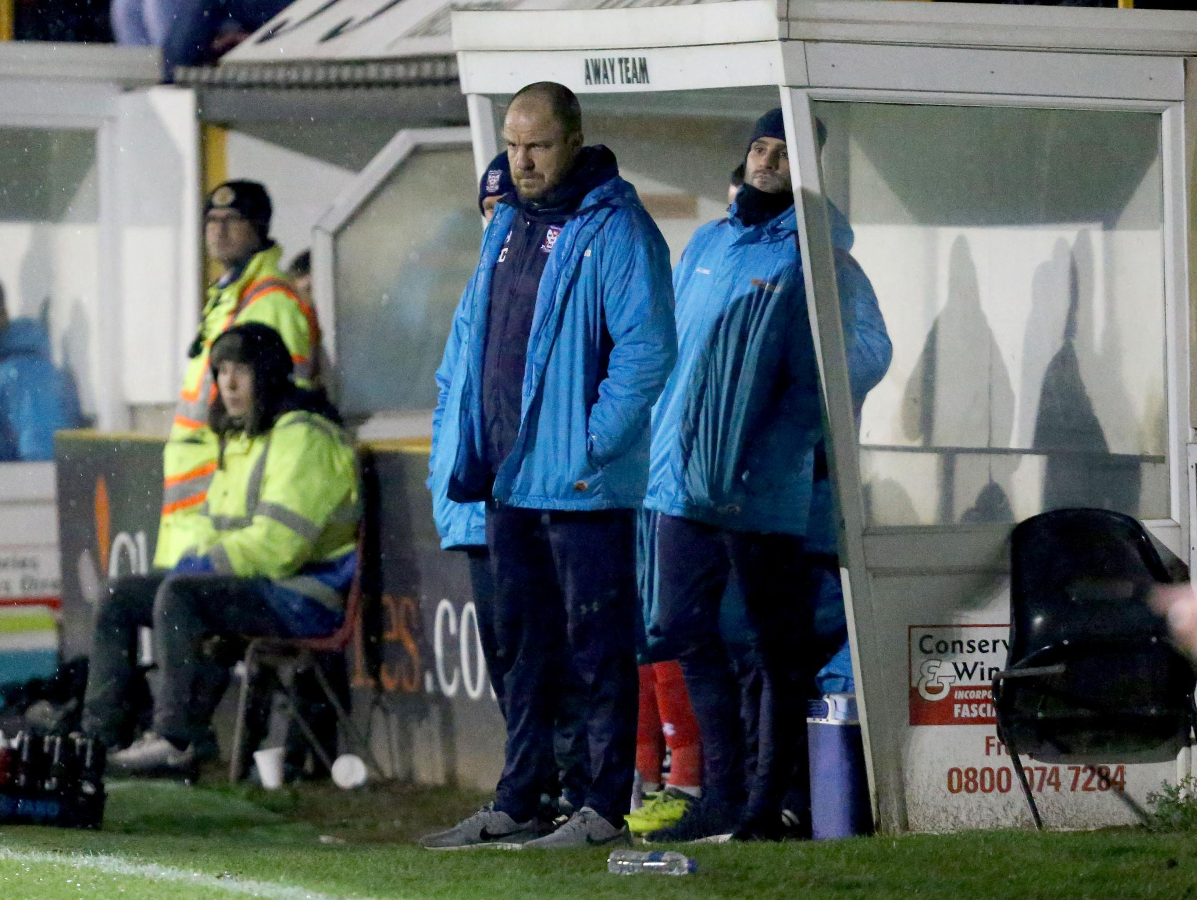 York City's Manager Sam Collins and  Assistant manager Stuart Parnaby look on as city slip to another defeat in the rain at Boston..Boston United v York City . Vanararma National League  North clash held at the Jakeman Stadium on the 08/12/2018.Pic by