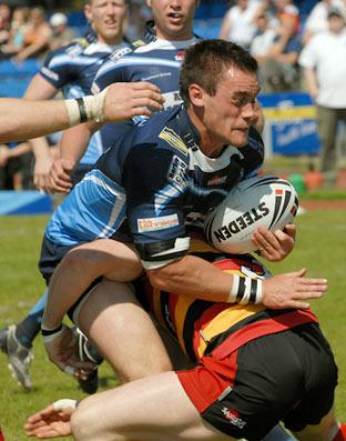 York City Knights' Jordan Ross is on the receiving end of a crunching tackle from a Dewsbury Rams opponent during  yesterday's 24-18 defeat at Huntington Stadium. Pictures: Frank Dwyer