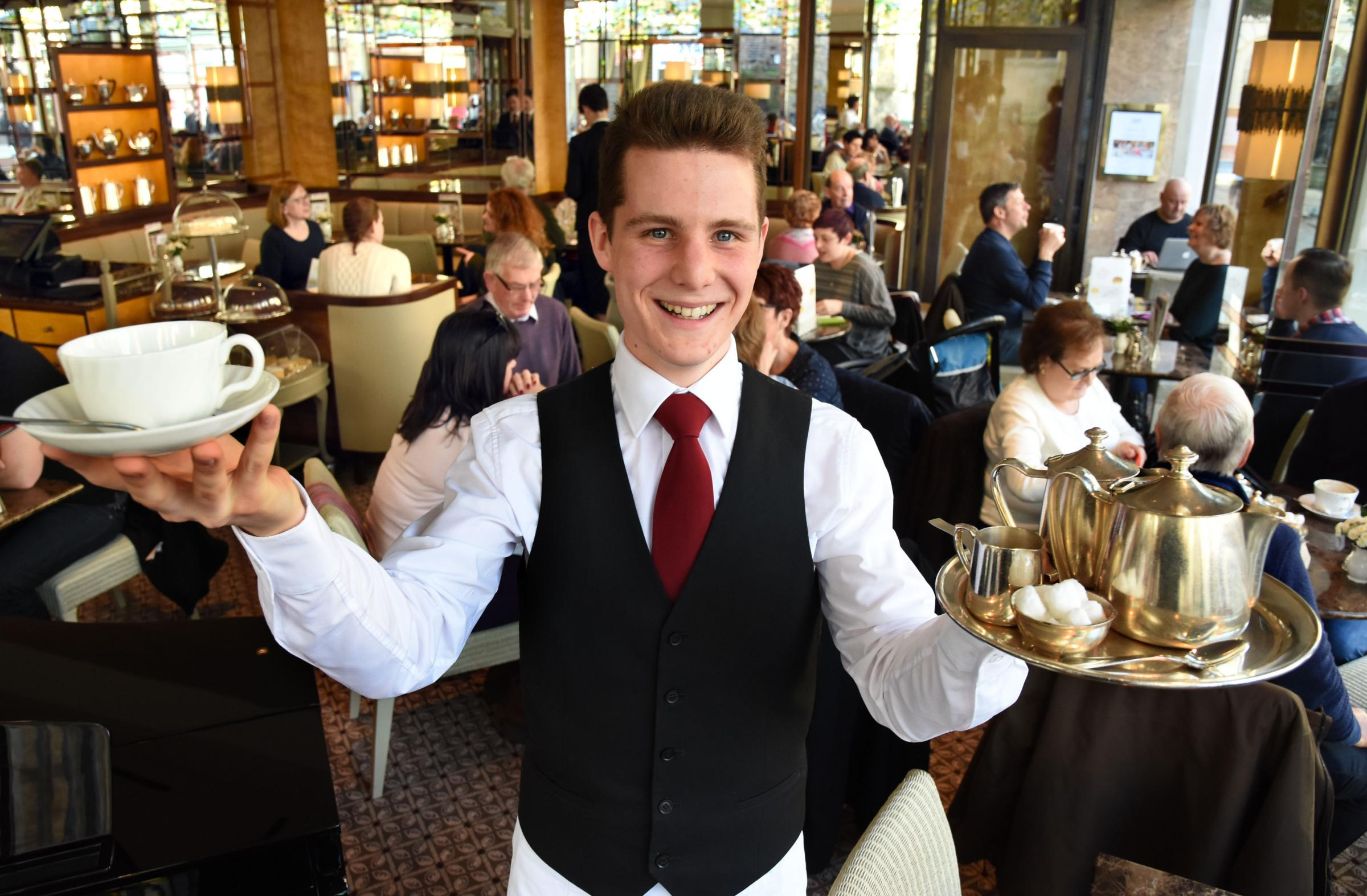 Waiter Ed Etheridge welcomes customers to the newly refurbished Betty's in York.Pic : Nigel Holland