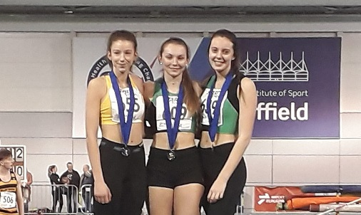 Lucy Hadaway (centre) and Amy Rolfe (right) came first and third, respectively, in the under-20 women's long jump