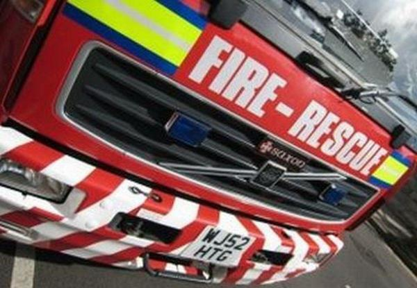 Fire crews were called to free a woman who was trapped in her vehicle after a collision in Malton last night