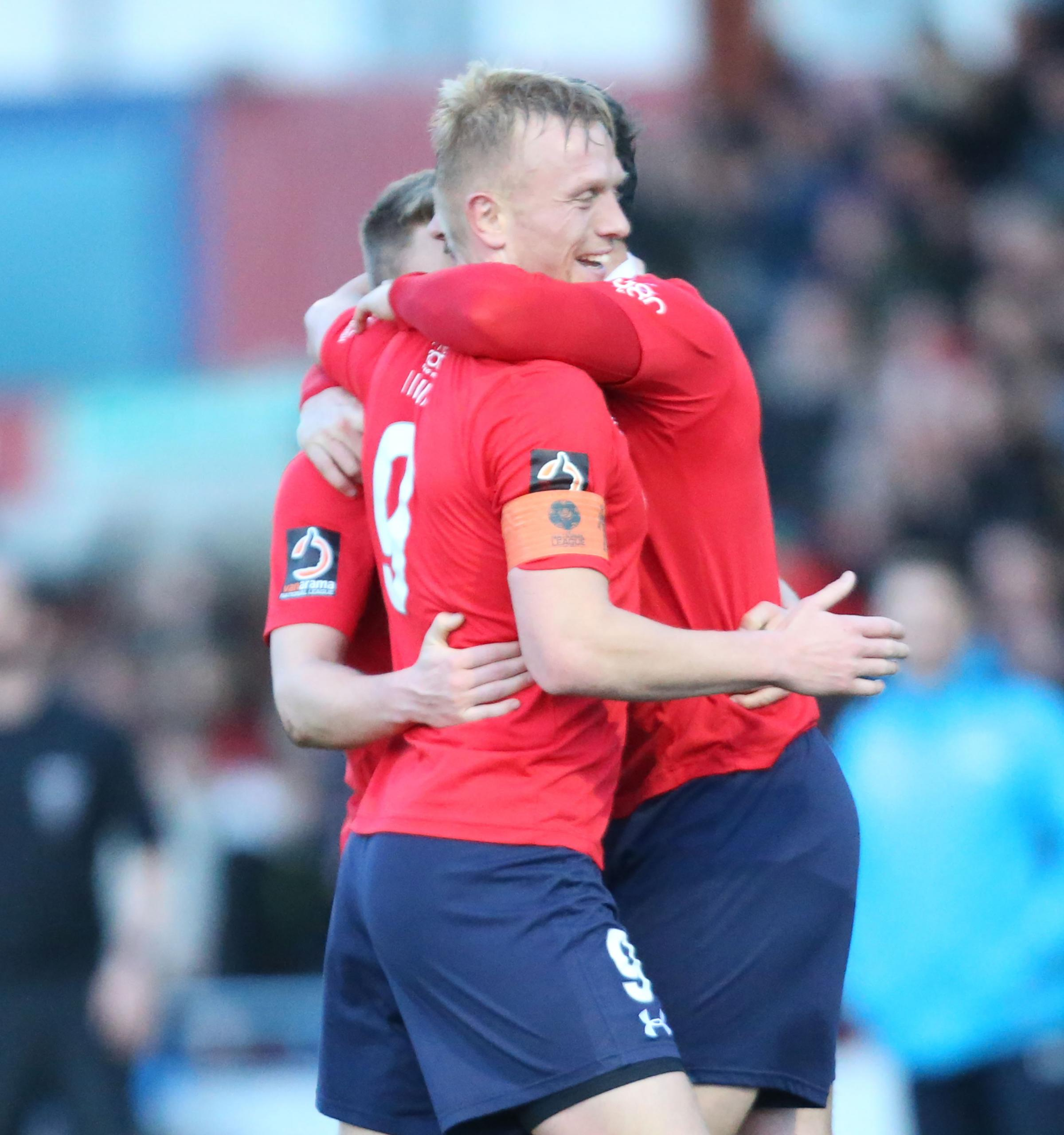 BRACING FINISH: Jordan Burrow is congratulated on his second York City goal against Ashton United. Picture: Gordon Clayton
