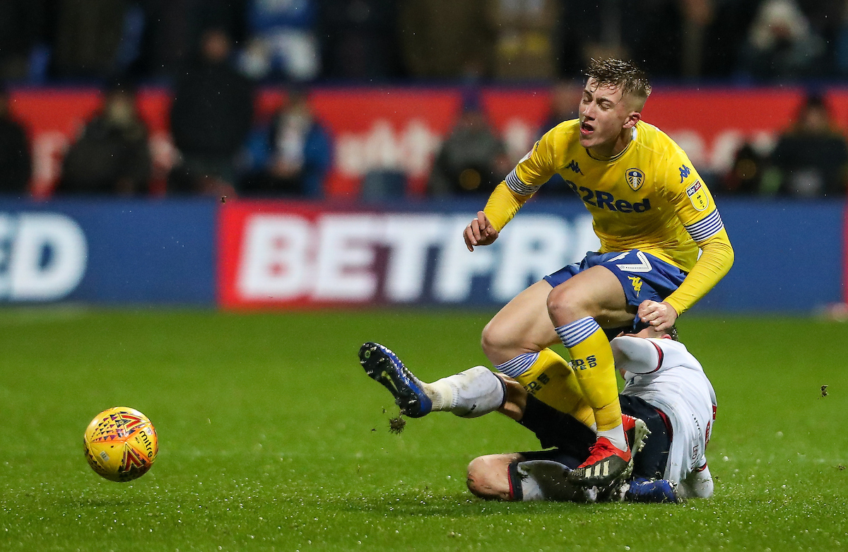 Bolton Wanderers' Andrew Taylor tackles Leeds United's  Jack Clarke..Photographer Andrew Kearns/CameraSport..The EFL Sky Bet Championship - Bolton Wanderers v Leeds United - Saturday 15th December 2018 - University of Bolton Stadium - Bolton..Worl