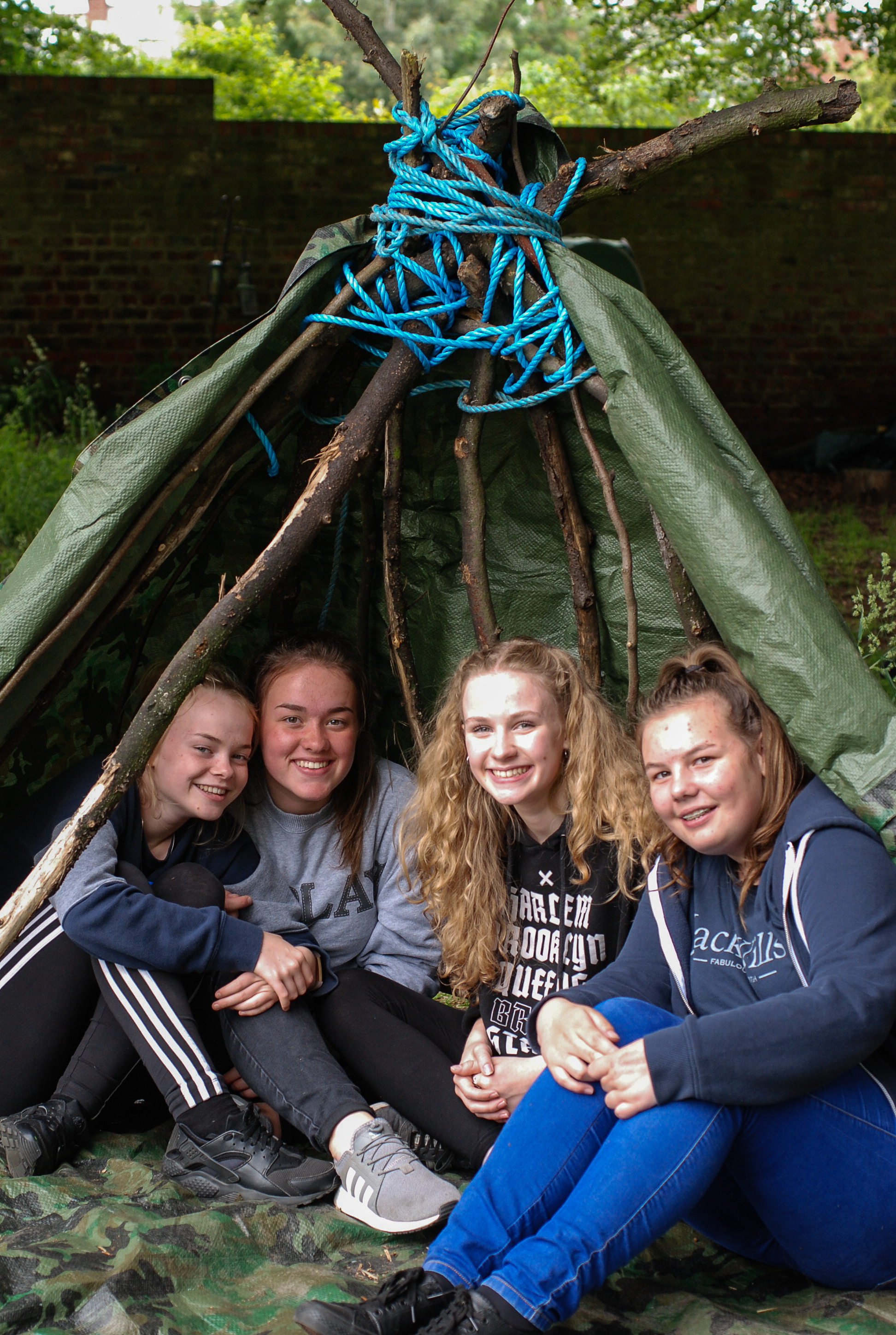 Children enjoying Wild Things Forest School, Millthorpe students on work experience with Wild Things