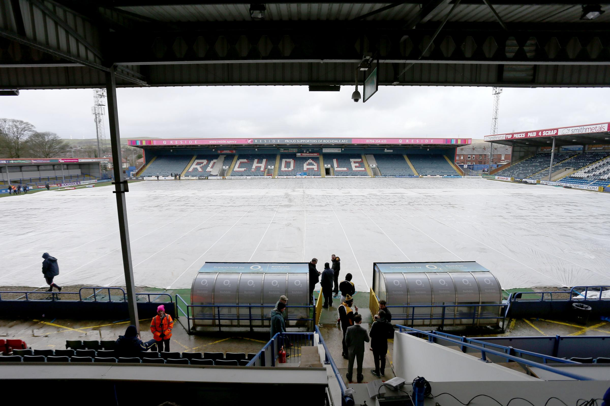Club and match officials mill around at Spotland prior to the game between Rochdale Hornets and York City Knights being controversially called off at late notice. Picture: Gordon Clayton
