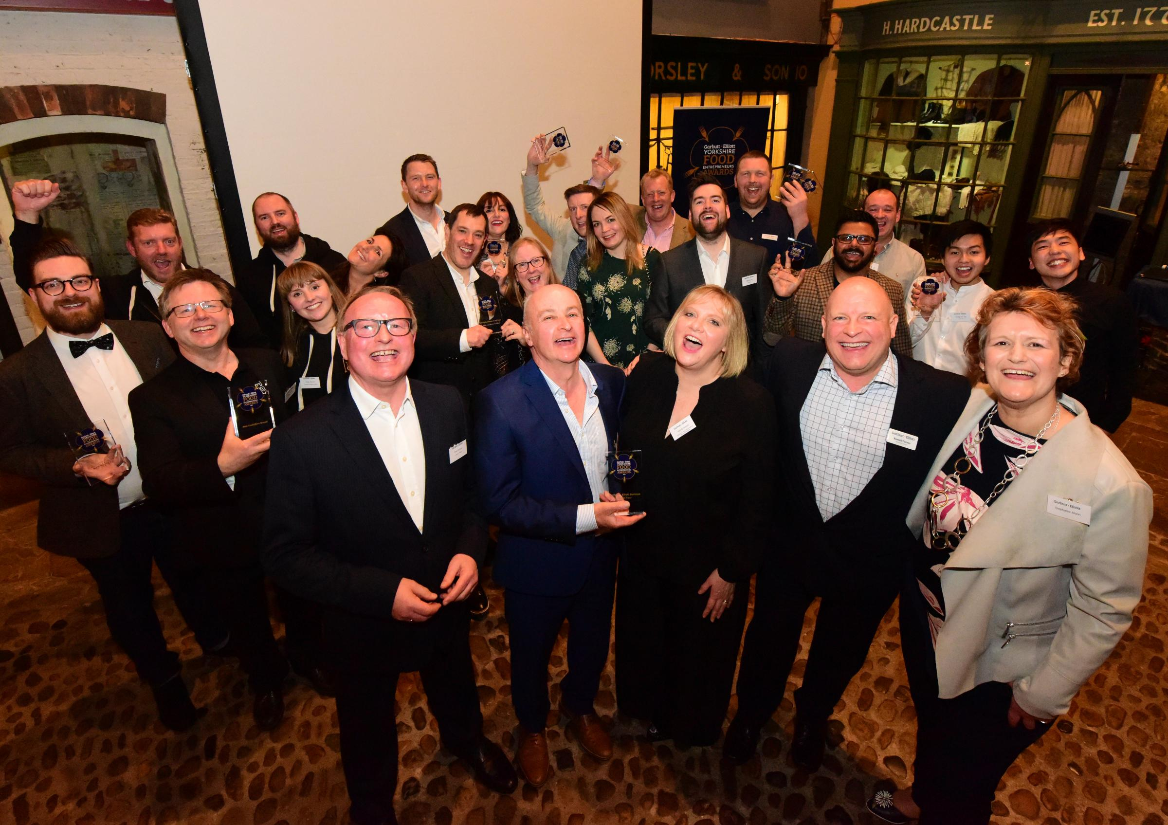 CHEERS: the winners at the Garbutt & Elliott Food Entrepreneurs Awards toast their success