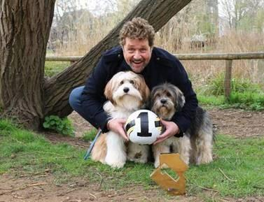 Top dog: Michael Ball celebrates his number one album with his dogs