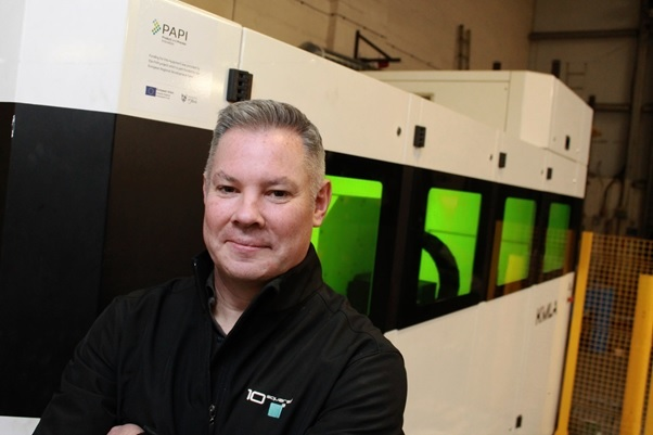 Gary Steele, general manager of 10Squared Ltd, with the new CNC laser cutting machine