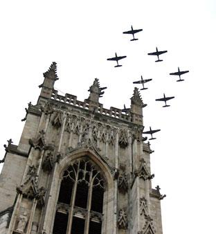 The Tucano squadron flies over York Minster