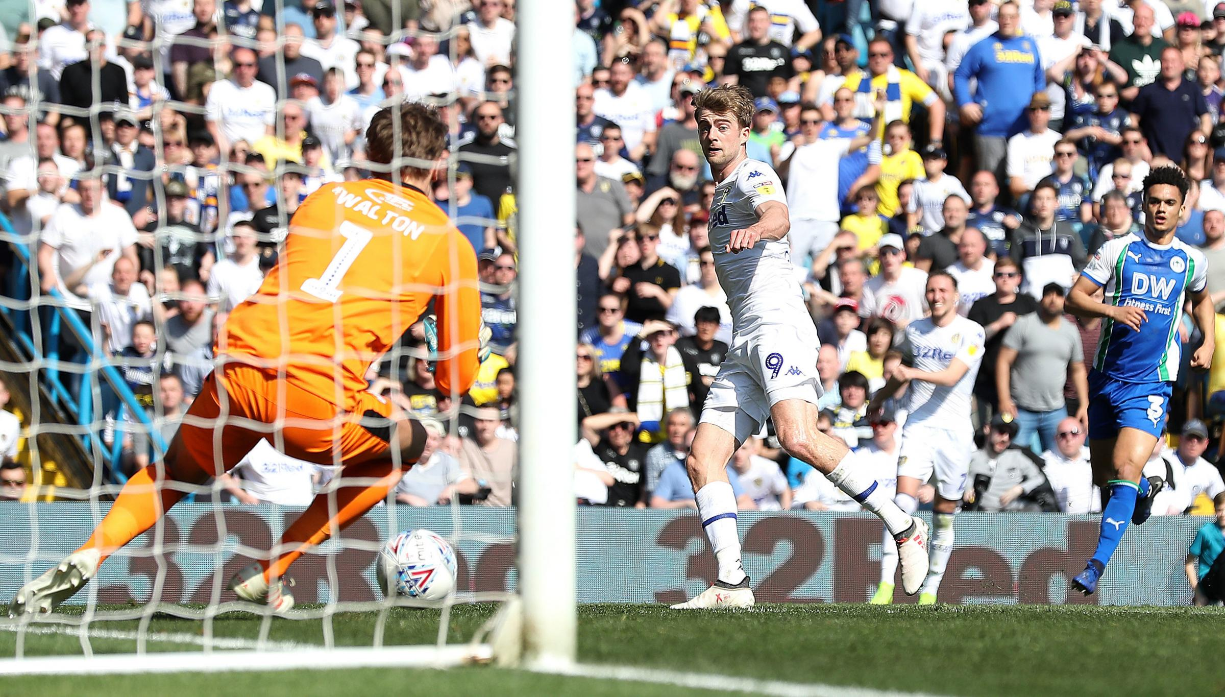 Leeds United's Patrick Bamford scores past Wigan Athletic goalkeeper Christian Walton, during the Championship match at Elland Road