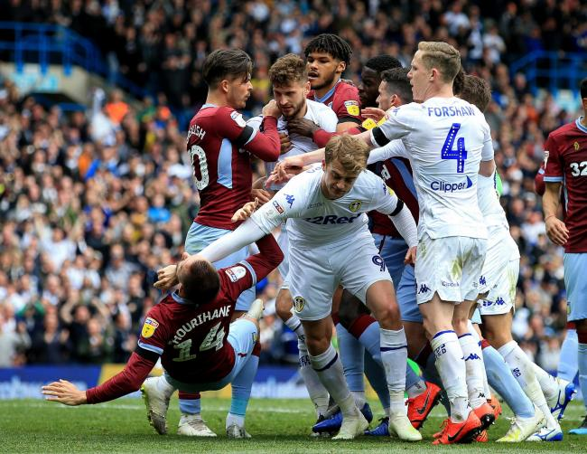 Leeds United's Patrick Bamford (right) and Aston Villa's Conor Hourihan are in the thick of a melee during yesterday's clash   Picture: Clint Hughes/PA Wire