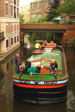 The Syntan barge makes its way up the River Foss in York, while visiting the city as part of the Festival Of The Rivers.
