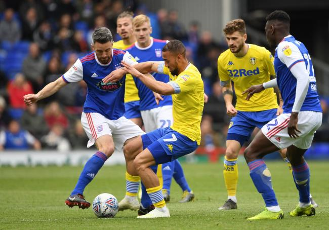 Ipswich Town's Cole Skuse, left, and Leeds United's Kemar Roofe during the former side's 3-2 in the Sky Bet Championship match at Portman Road