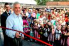 Ken Exton, children's centre programme manager at City of York Council, opens the new Children's Centre at Haxby Road Primary School, watched by head teacher Mike Schofield