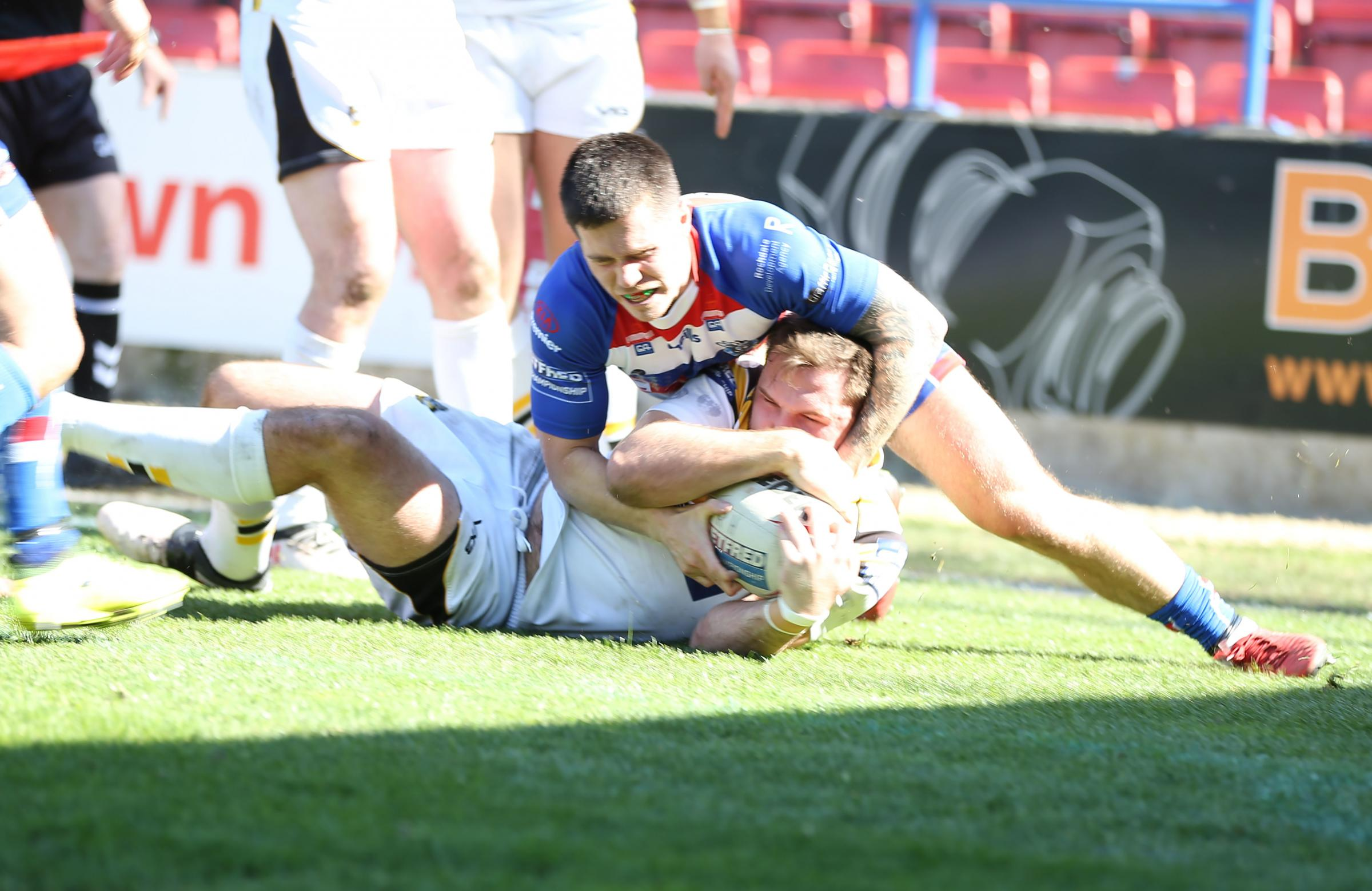 Rochdale Hornets' James Worthington can't stop York City Knights' Jason Bass from scoring his second try of the narrow Betfred Championship victory at Spotland. Picture: Gordon Clayton